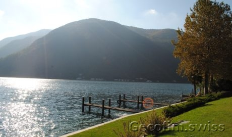 Modern terraced villa overlooking the lake of Lugano with boathouse in Melano
